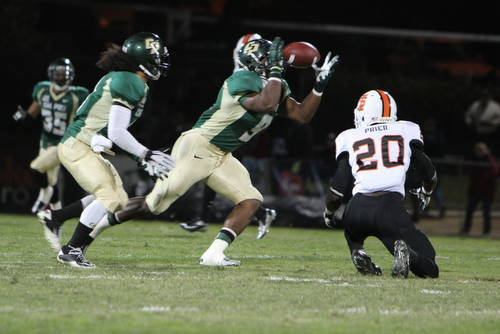 Kennith Jackson grabs one of his two first-quarter interceptions in Cal Poly's 56-point win vs. Idaho State.