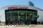 Staples Center is home to both the Clippers and Lakers but is more known to represent the purple and gold. By Prayitno from Los Angeles, USA (Staples Center) [CC-BY-2.0 (http://creativecommons.org/licenses/by/2.0)], via Wikimedia Commons