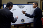 Despite this picture being from 2009, not even Barack Obama could have predicted what would transpire thus far in the 2014 tournament, Pete Souza [Public domain], via Wikimedia Commons