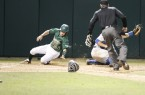 Jimmy Allen slides home safely for Cal Poly's seventh run in the fourth inning. Cal Poly wouldn't score again until the 9th. By Owen Main