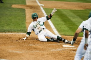 Cal Poly's Nick Torres slides into home safely after a bases-loaded single turned into a three-run error. By Owen Main