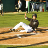 Zack Zehner slides home safely in Cal Poly's three-run first inning. By Owen Main