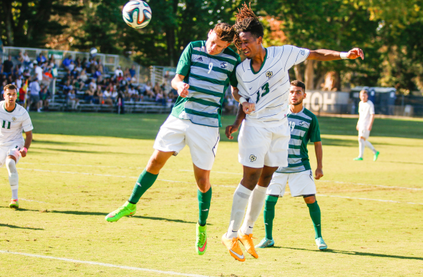 Cal Poly's Kaba Alkebulan battles for an arial ball on Saturday afternoon in Sacramento. By Owen Main
