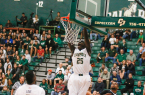Joel Awich throws down a dunk in the second half. By Owen Main
