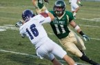 Johnny Millard makes a tackle in a 2013 game against Weber State. By Owen Main