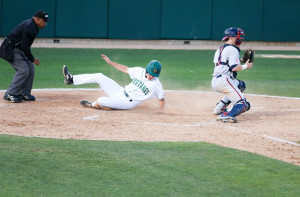 Ryan Drobny slides home safely on a Peter Van Gansen sacrifice fly on Tuesday night. By Owen Main
