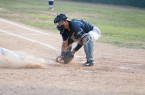 Ryan Sluder is thrown out at home plate in the first inning of Saturday's game. By Owen Main